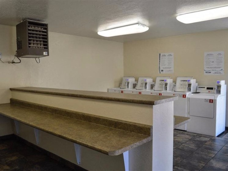 Separate Area for Washers and Dryers at Country Club Terrace Apartments, 5404 East Cortland Blvd, 86004