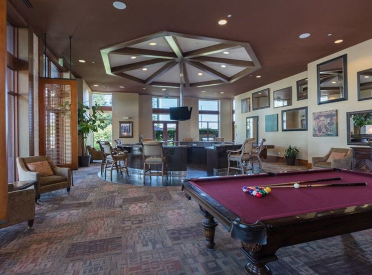 clubroom with bar seating and pool table