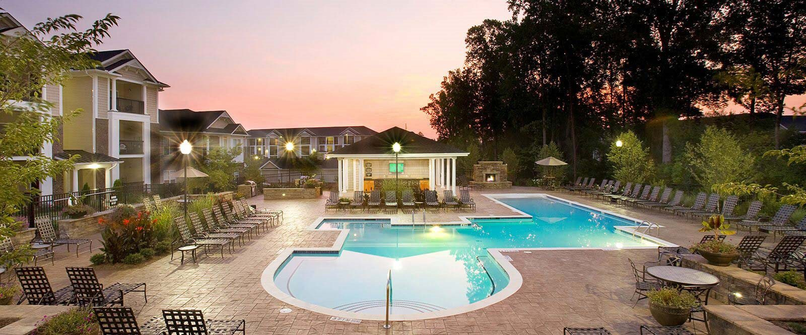 Poolside Sundeck and Grilling Area at Abberly Place at White Oak Crossing by HHHunt, Garner