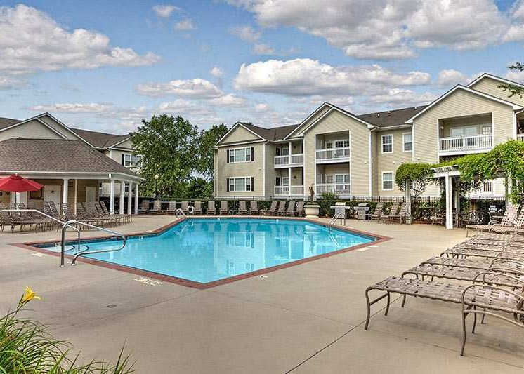Take a dip in our resort-style swimming pool at Abberly Woods Apartment Homes by HHHunt, Charlotte