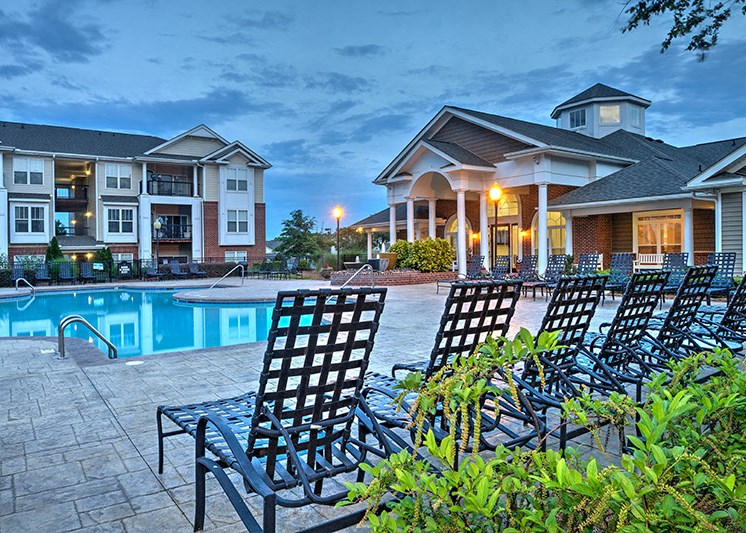 Refreshing pool with spacious sundeck and a city view at Abberly Woods Apartment Homes by HHHunt, North Carolina, 28216