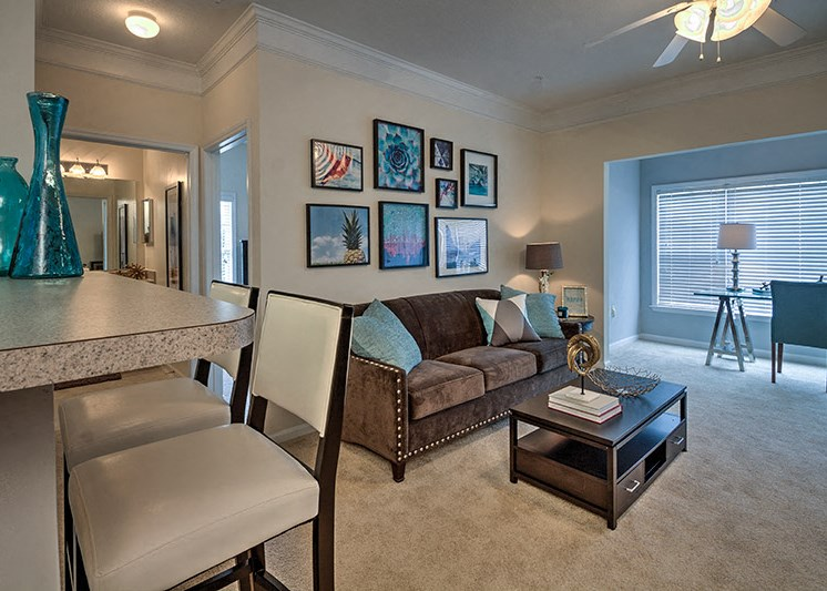 Living Room with Faux-Hardwood Floors at Abberly Woods Apartment Homes by HHHunt, Charlotte, NC