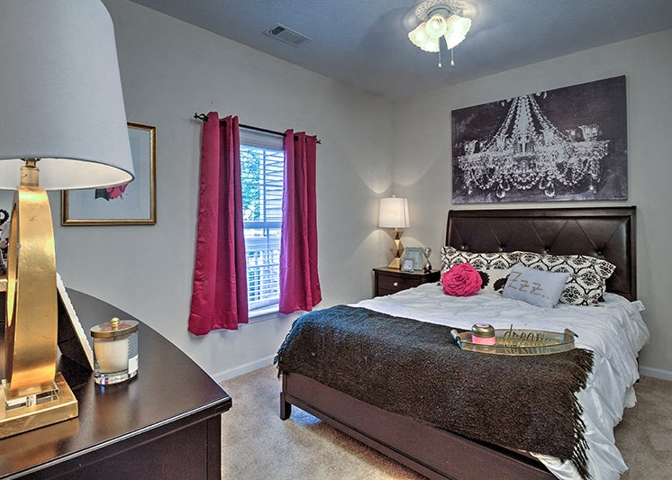 Wood-look flooring extends to bedrooms in select homes at Abberly Woods Apartment Homes by HHHunt, Charlotte, 28216