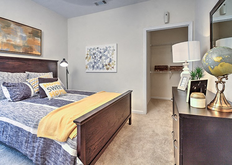 Bedroom with built-in desk at Abberly Woods Apartment Homes by HHHunt, North Carolina