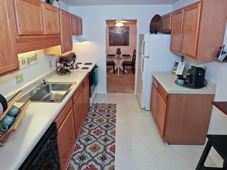 Kitchen with wood style cabinetry at Foxridge Apartment Homes, Virginia, 24060