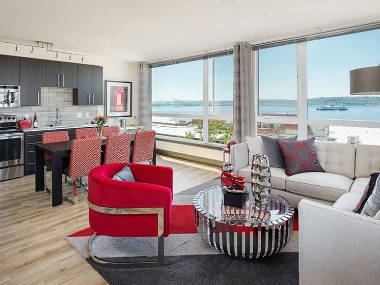 Apartments Downtown Seattle - ArtHouse Apartments Open and Spacious Living Room with Modern Designs and Lots of WIndows Letting in Natural Light and a Great View of the Water
