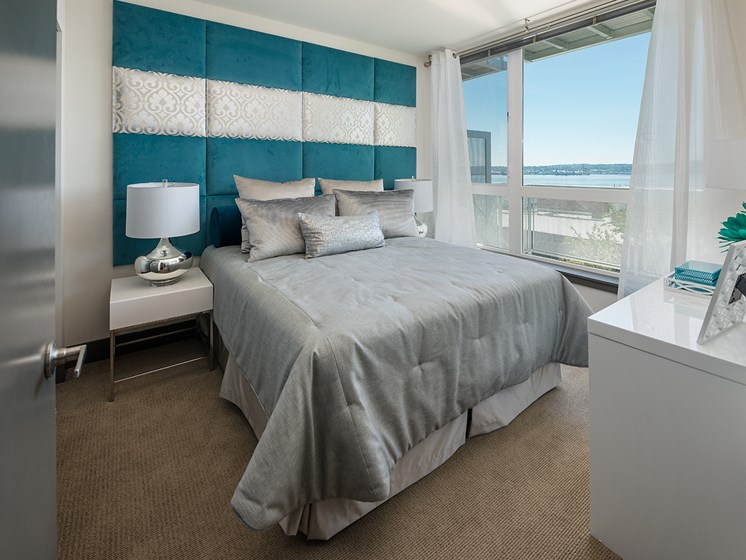 Apartments Downtown Seattle WA - ArtHouse Apartments Master Bedroom with Large Closet and Beautiful Waterfront View