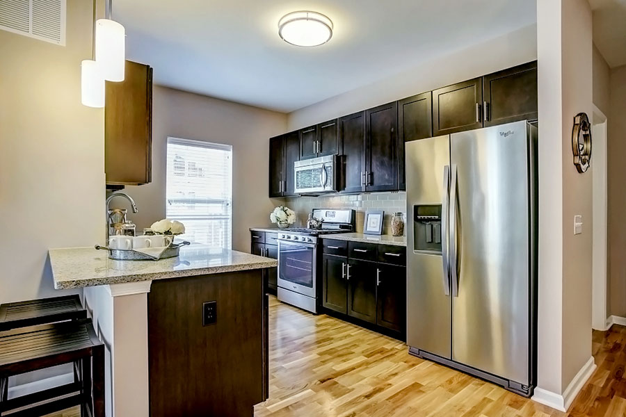 Fully Equipped Kitchen Includes Frost-Free Refrigerator, Electric Range, & Dishwasher at The Hillside Club, Livingston, 07039
