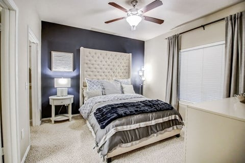Spacious bedrooms with large windows for natural lighting, ceiling fan and plush carpet