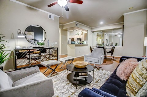 Gorgeous living room with hardwood style flooring, crown molding and ceiling fan