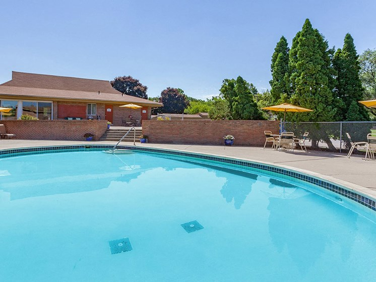 Lounging by the Pool at Cranbrook Center Apartments,Southfield, 48076