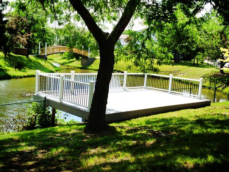 Deck over lake Sterling Lake Apartments & Townhomes, Sterling Heights, MI