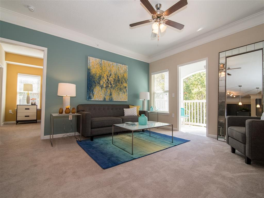 cozy living room with walk-out balcony