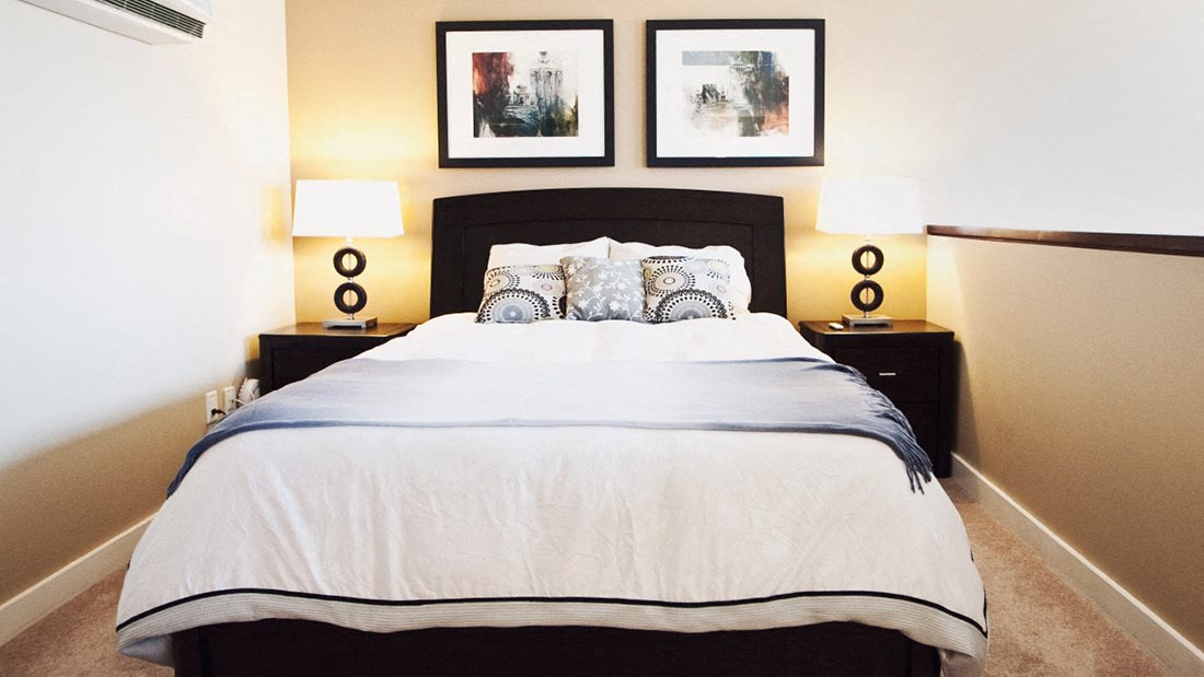 Bedroom with Two Night Tables and Wall Art