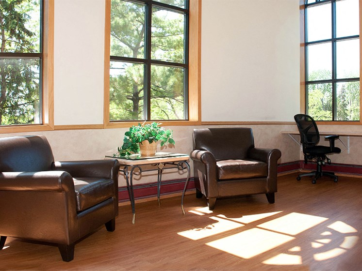 Community room with leather chairs and desk chairs