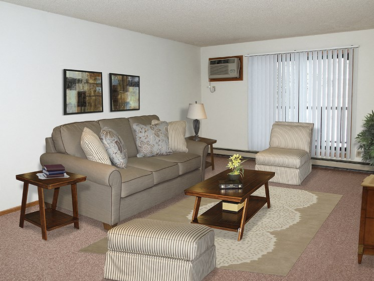 Living room with sofa and chairs and coffee table