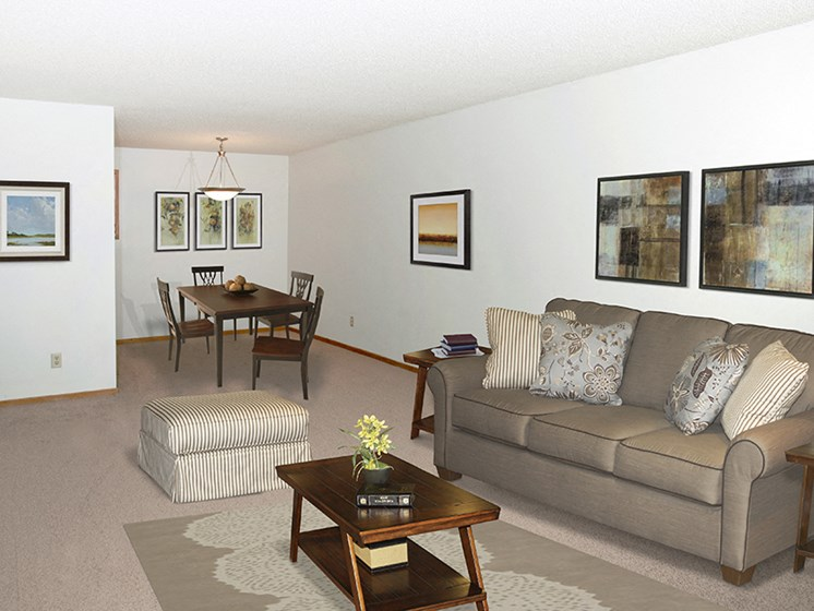 Living and dining room with furniture and wall art