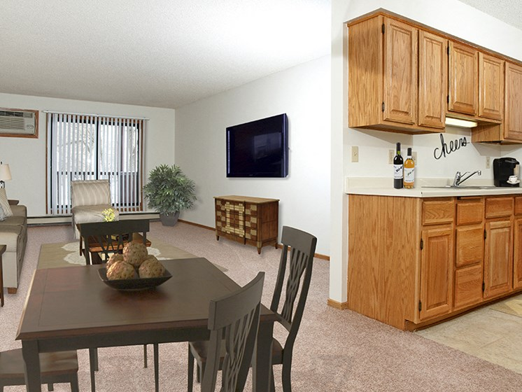 Wide shot of living room, dining table, and kitchen
