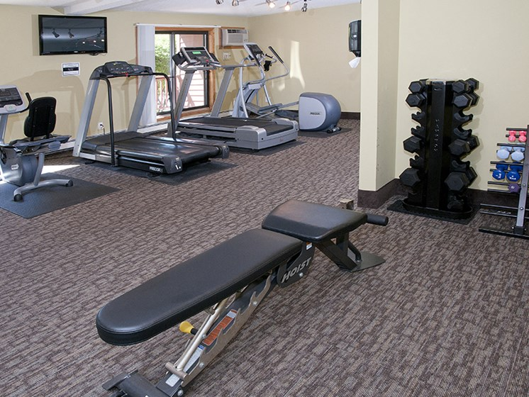 Fitness room with weights, elipticals, and treadmils