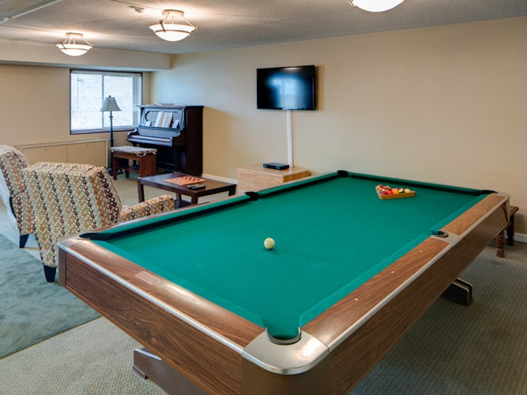 Community room with pool table and a piano