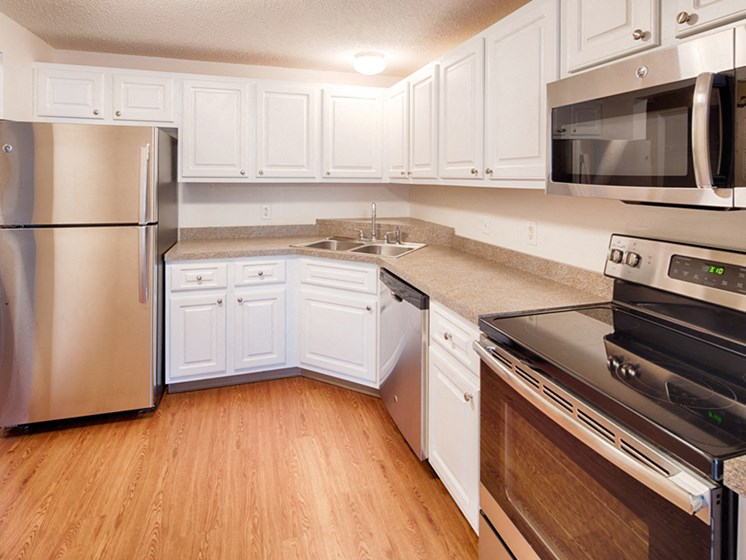 Kitchen with hardwood floors, and stainless steel appliances