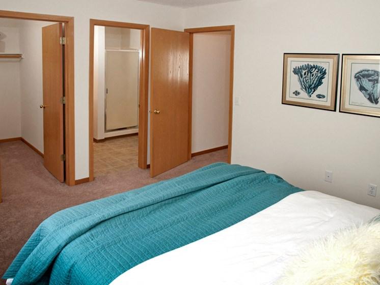 bedroom with multiple open doors