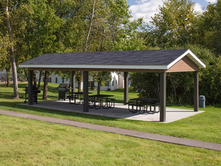 outdoor gazebo with benches underneath it