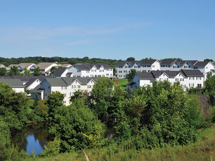overlooking shot of multiple townhomes and trees