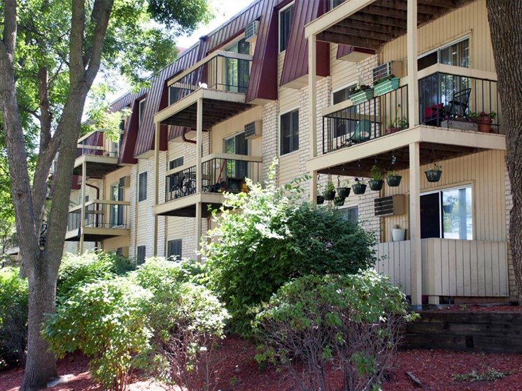 Exterior shot of apartments with patios and decks