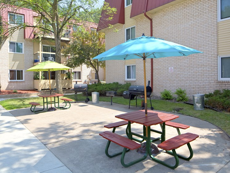 Outdoor picnic tables with colorful umbrellas