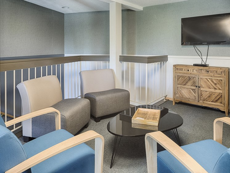 Community room with chairs facing a television