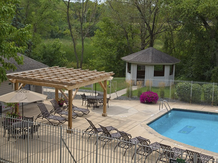 Outdoor pool with lounge chairs and sun terrace
