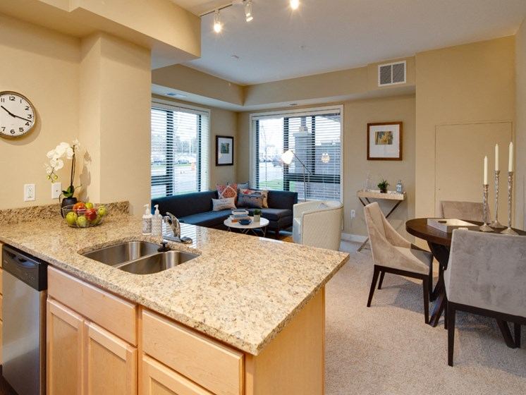 Apartment home with kitchen island facing a living room