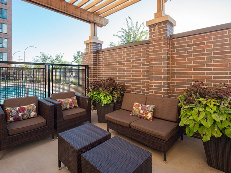 outdoor patio / sun terrace overlooking a pool