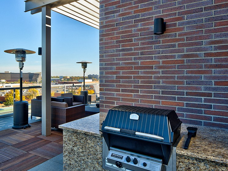 Grill and patio seating on the roof