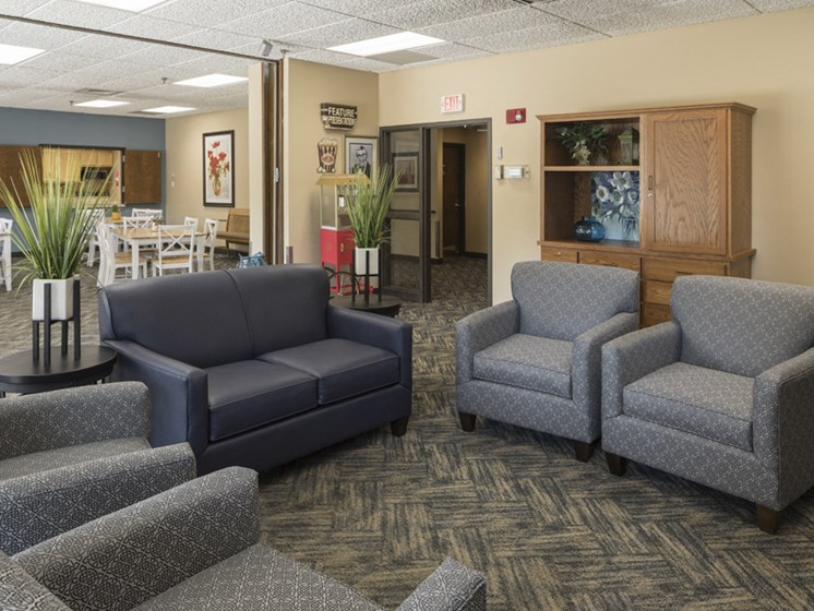 community room with gray chairs and sofas