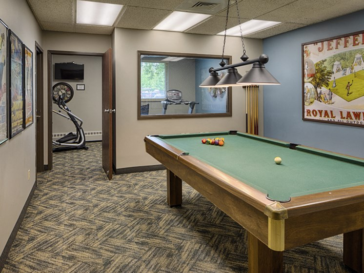 Rec room with a pool table and view of small fitness room