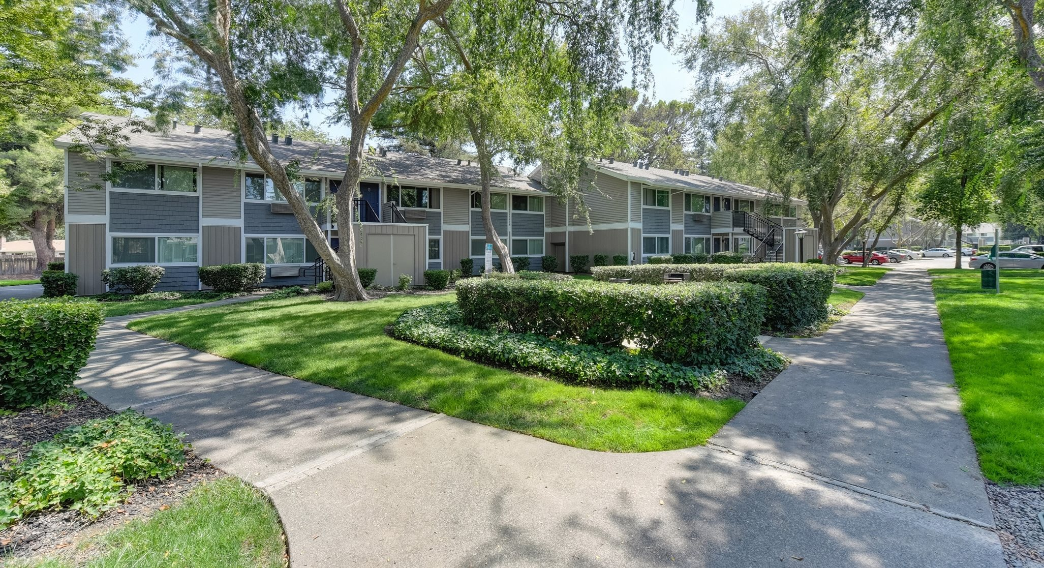 Apartment Grounds Exterior with Walking Paths, Grass and Trees