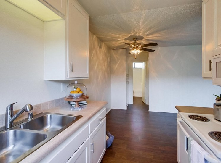 Kitchen and counters with wood flooring - Mesa Vista Apartments