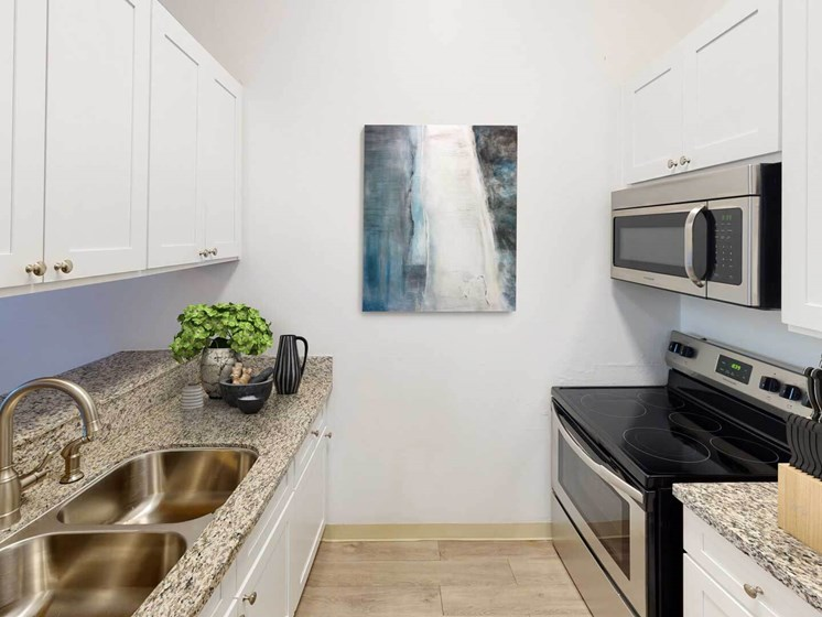 Updated Kitchen With Black Appliances at Oxnard Plaza, North Hollywood