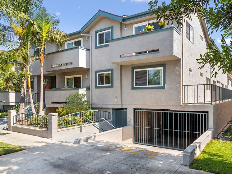 Property Exterior Front Entrance with Garage at Elmwood Gardens Apartments in Burbank, CA