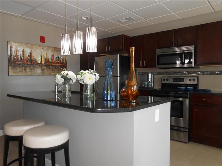 Fitted Kitchen With Island Dining at The Residences At Hanna, Ohio, 44115