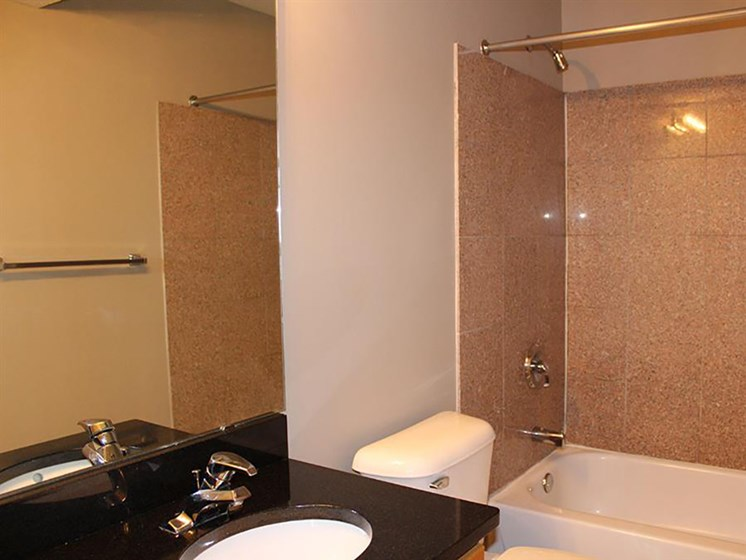 Designer Granite Countertops In All Bathrooms at Stonebridge Waterfront, Cleveland, Ohio
