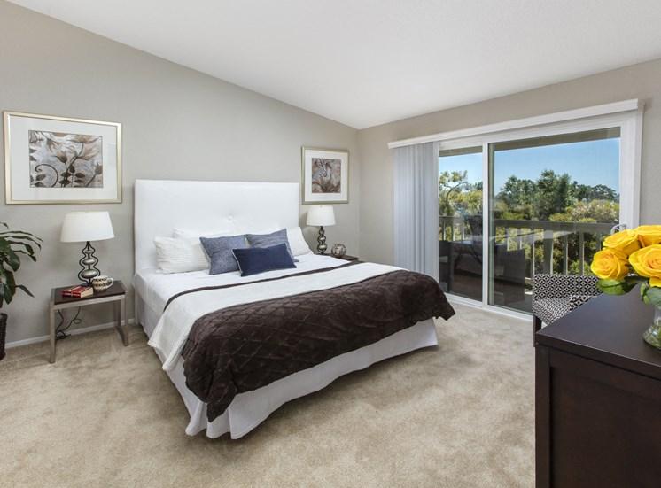 Bedroom with sliding glass doors to balcony