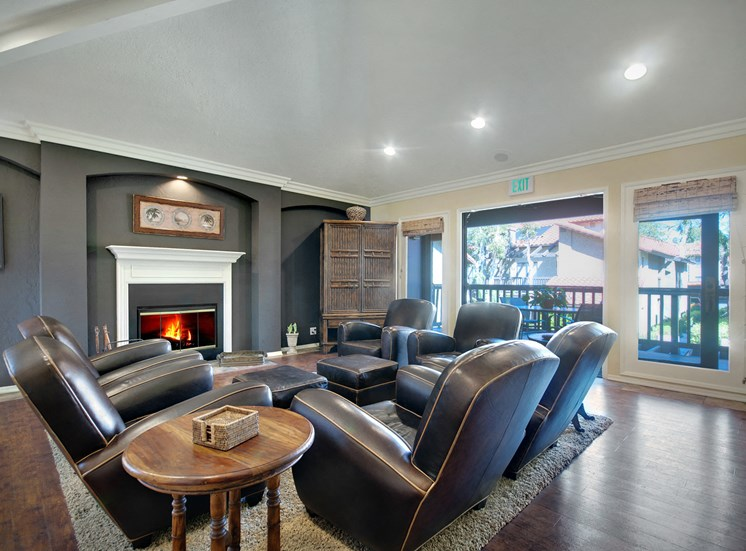 Clubroom with seating area and fireplace