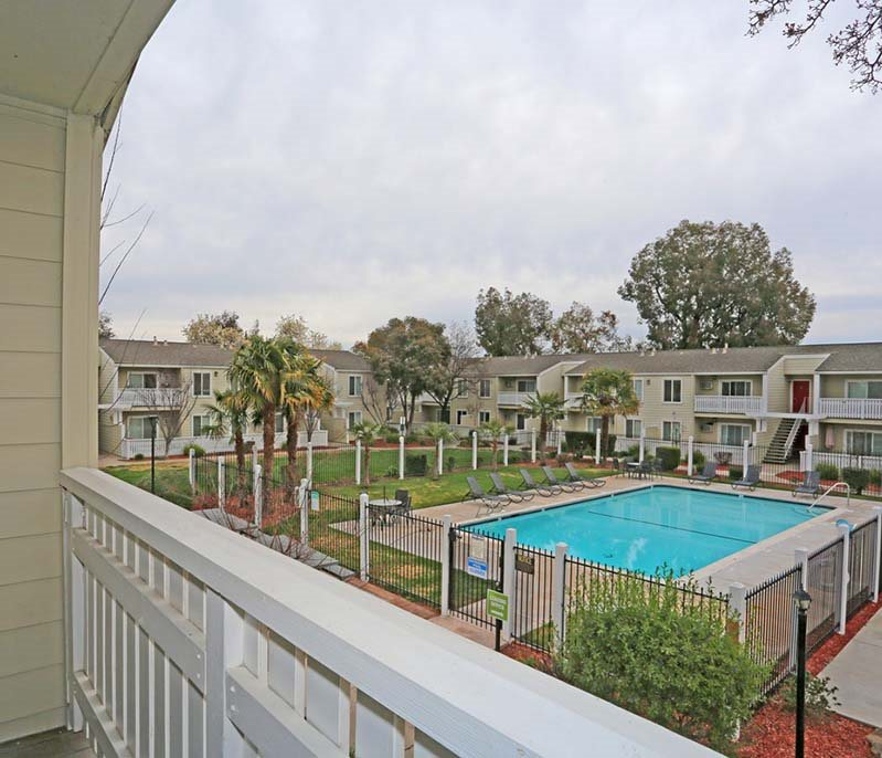 View of pool from balcony l Park Brentwood CA Apartments for rent