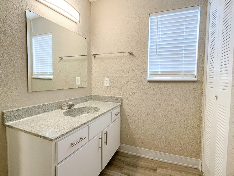 Large bathroom with spacious vanity and closet near the Plaza, Westport, and downtown Kansas City