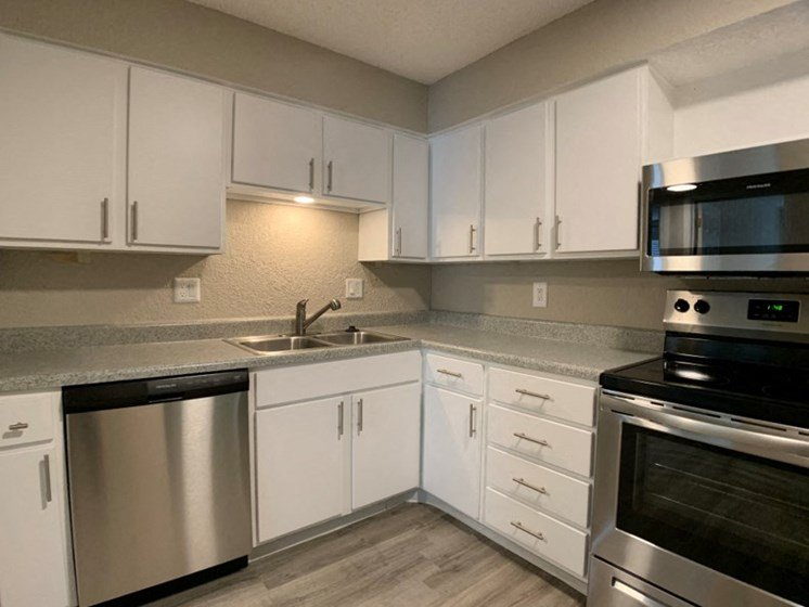 Kitchen with stainless steel appliances and ample storage space near the Plaza, westport, and downtown Kansas City