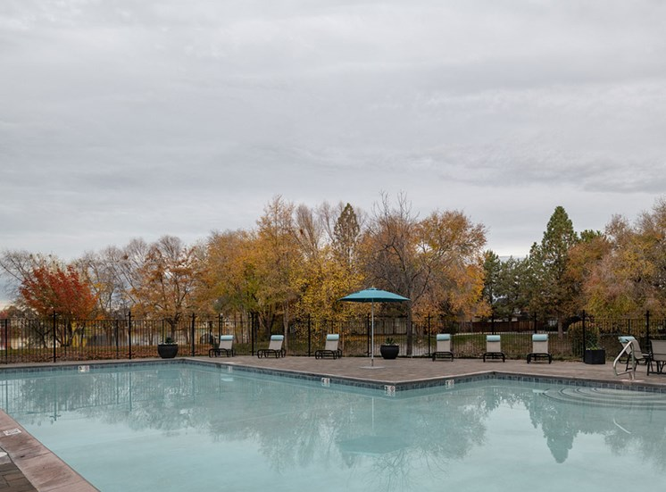 Relaxing Pool Area With Sundeck at Edgewater Apartments, Boise, ID, 83703