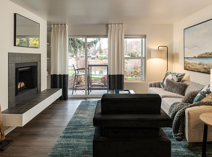 Television And Fireplace In Living Room at Edgewater Apartments, Idaho, 83703